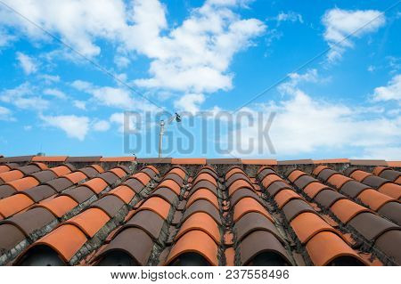 Roof With Terracotta Tile In Miami, Usa. Tile Roofing On Cloudy Blue Sky. Architecture And Design. R