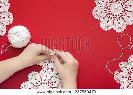 Woman Crocheting Hands. Crochet Cotton Lace Handmade Doily And Crochet Hook