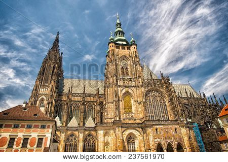 St.vitus Cathedral In Prague, Czech Republic. Church Building On Cloudy Blue Sky. Monument Of Gothic