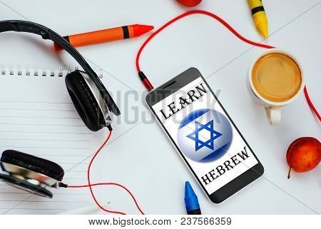 Smartphone With Israel Flag And Headphones. Concept Of Hebrew Learning Through Audio Courses
