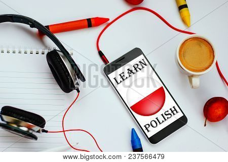 Smartphone With Polish Flag And Headphones. Concept Of Polish Learning Through Audio Courses