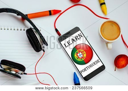 Smartphone With Portuguese Flag And Headphones. Concept Of Portuguese Learning Through Audio Courses