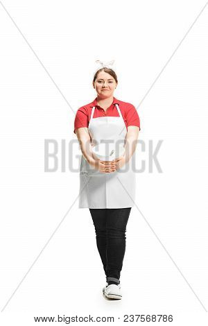 Portrait Of Cute Smiling Woman With Bowl In Her Hands In The Studio, Isolated On White Background. F