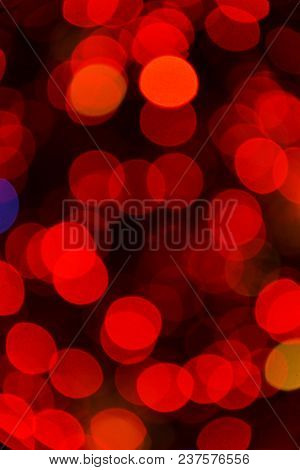 Defocused Christmas Lights Background. Abstract Bokeh Background. Christmas Glittering Background. A