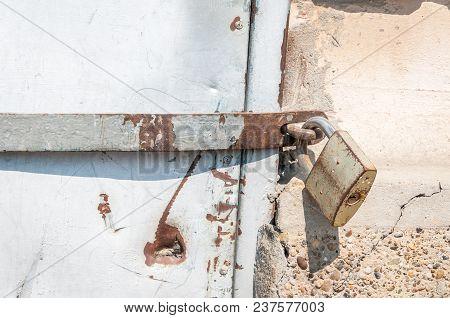 Locked Golden Padlock Lock Old Rusty Metal Door Close Up