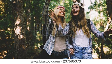Beautiful Young Women Spending Time In Nature Exploring And Hiking