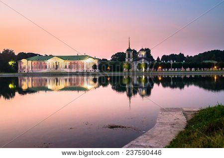 Admirable pink sunset sky over the architectural ensemble of the State reserve museum Kuskovo, former aristocratic summer country estate of the russian nobility of the 18th century. Moscow. Russia. poster