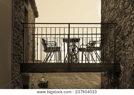 Terrace With Chairs Between Two Houses, Sepia Toning