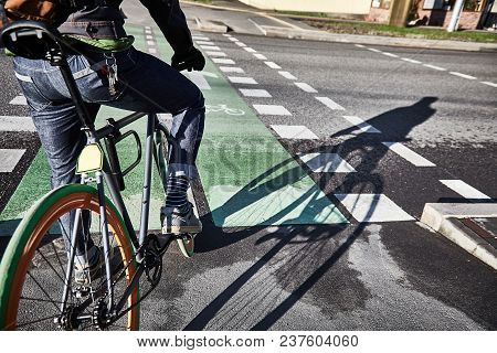 A Cyclist Is Riding A Bike Path. Bicycle In The City. Eco-friendly Mode Of Transport. Morning In The