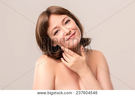 Nude Woman With Sloped Head And Charing Face. Posing On Camera. Having Deep Look. Mid Age Woman Over