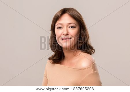 Attractive Lady With Awesome Face Features Posing On Camera In White Studio. Mid Age Woman Over 35 Y