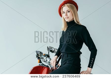 Attractive Young Woman Standing By Red Scooter Isolated On Grey