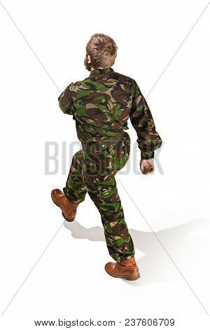 Back Of Young Army Soldier Wearing Camouflage Uniform Going Isolated On White Studio Background In F