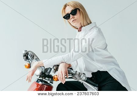 Attractive Young Woman In Sunglasses On Vintage Scooter Isolated On Grey