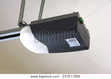 Close-up Of An Automatic Garage Door Opener Motor On The Ceiling.