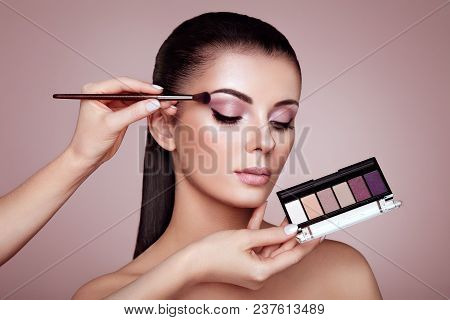 Makeup Artist Applies Eye Shadow. Beautiful Woman Face. Perfect Makeup. Make-up Detail. Beauty Girl