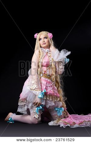 Attractive girl posing in fairy-tale doll costume