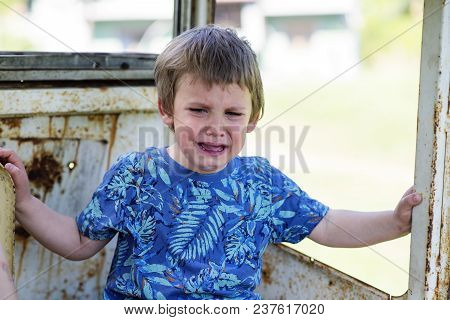 Little Boy Crying Alone Outside, Sad Face And Tears