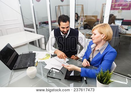 Analytic Manager Team Working Process, Bearded Man And Blonde Businesswoman Dressed In Suits Work Wi