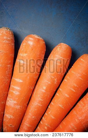Close-up of a carrots on a blue background.