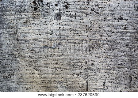 Grunge Style Texture Of Old Damaged Roofing Paper With Cracks And Spots. Gray Rough Background.