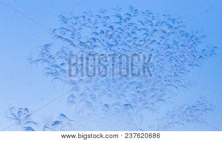 Blue Drawings On The Glass In The Frost .