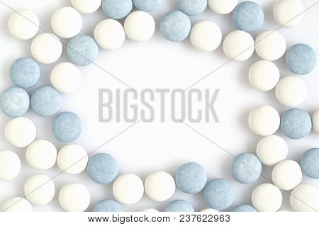White And Blue Pills On Light Surface