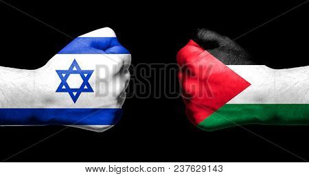 Flags Of Israel And Palestine Painted On Two Clenched Fists Facing Each Other On Black Background/is