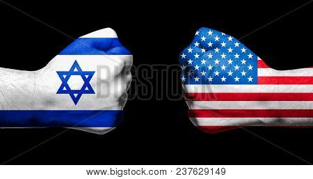 Flags Of Israel And Usa Painted On Two Clenched Fists Facing Each Other On Black Background/israel -