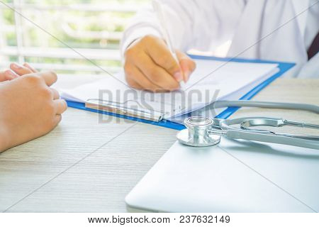 Healthcare Medical Concept. Man Doctor Writing Prescription Clipboard With Record Information Paper