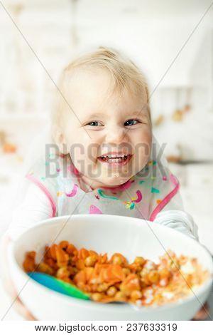 Happy Children Eating Steamed Vegetables At Home Kitchen