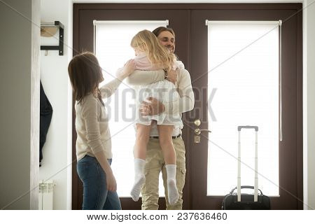 Happy Father Hugging Little Daughter Arriving Returning After Long Trip, Smiling Dad Holding Kid Gir