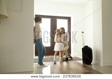 Little Kid Girl Embracing Dad Leaving Family Moving Out With Travel Case, Sad Daughter Hugging Fathe