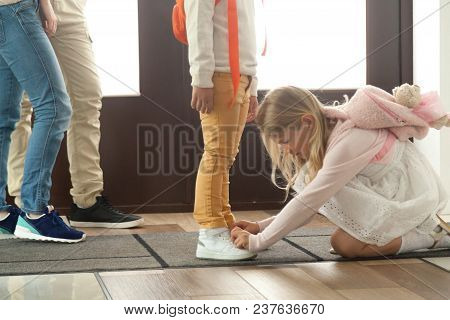 Sister Helping Brother To Tie Shoes Preparing Go To School, Kid Girl Fasten Shoelaces Of Child Boy,