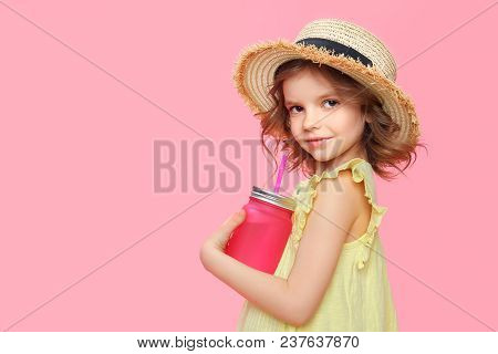 Side View Of Pretty Little Model In Straw Hat And Summer Dress Holding Glass With Refreshing Lemonad