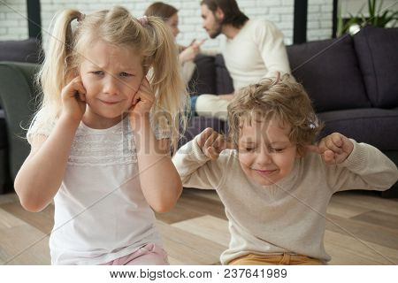 Children Put Fingers In Ears During Parents Fight At Home, Sad Stressed Son Daughter Feel Hurt Suffe