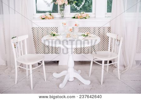 Dining Table Setting At Provence Style, With Candles, Lavender, Vintage Crockery And Cutlery, Closeu