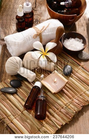 Spa setting on wicker mat with old wooden background