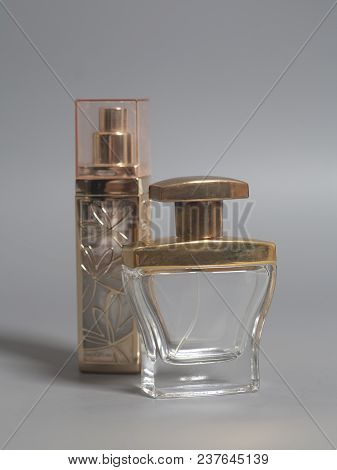 Men's And Woman Perfume In Bottles