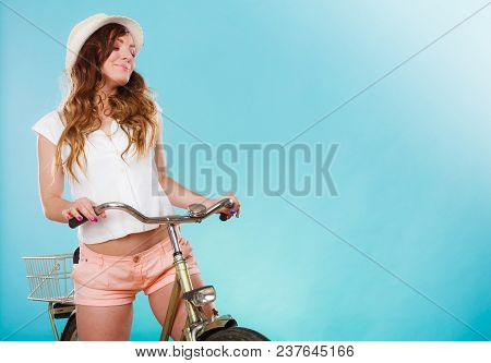 Young Active Woman Girl Riding Bike Bicycle. Healthy Lifestyle And Recreation Leisure Activity. Stud