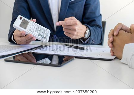 Businessman Being Analysis And Making The Decision A Car Insurance Policy, Agent Man Is Using Calcul