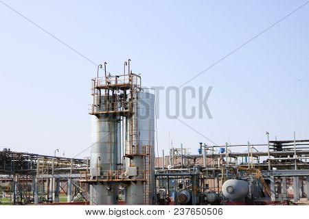 Two Huge High Metal Tanks, Barrels, Heat Exchange Equipment, Pumps, Pipes, Pipeline Estocad At The O