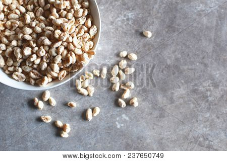 Puffed Wheat With Roasted Sugar In White Bowl On Grunge Grey Background Top View With Copy Space For