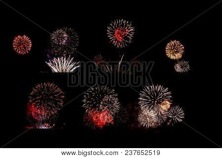 Set Of Multi-colored Fireworks Lights On Black Isolated Background.
