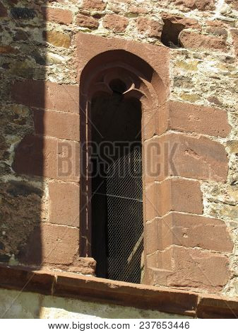 Detail Of The Ruins Of A Gothic Monastery, Stone Masonry With A Typical Gothic Window, Architectural