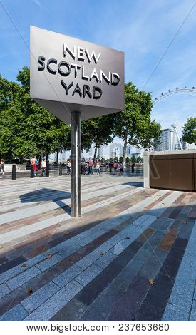 London, United Kingdom - August 28, 2017 - New Scotland Yard Sign With The London Eye In The Backgro