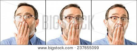 Middle age handsome man closeup covers mouth in shock, looks shy, expressing silence and mistake concepts, scared