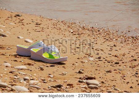 White Sandals On The Beach. Beach Fashion. Copy Space