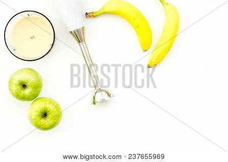 Homemade Baby Food. Cook Puree With Apple And Banana With Immersion Blender. White Background With T