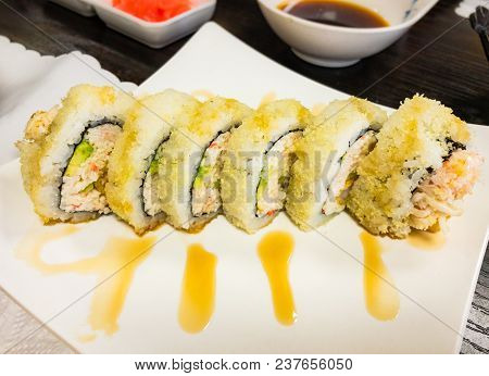 Close Up Shot Of Delicious Spicy Shrimp Tempura Roll Sushi. Mouth Water Sushi Roll Perfect For Your